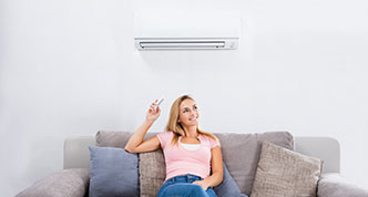 Woman under air conditioning