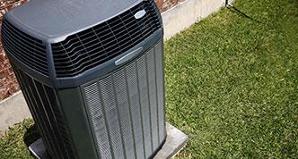 Air conditioner near grass