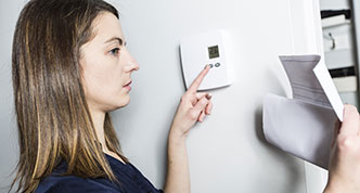 Checking both thermostat and heating bill